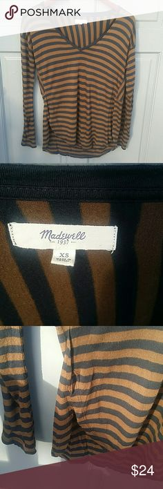 "Madewell Brown and Black striped long sleeve tee Excellent condition. Generous Size XS. High low design. Lightweight and long sleeve. V Neck. Appx measurements: -Length 24"" in front and 27"" in back  -Bust 18"" -Sleeves 20"" Madewell Tops Tees - Long Sleeve"