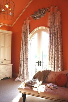 love the victorian accents against the mod orange wall