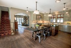 Transitional Dining Room with Pendant light, High ceiling, Hardwood floors