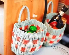 A functional and beautiful campervan storage idea.. These baskets hook on and off and securely store those tricky glass containers when you're on the move.