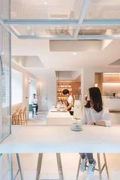 A series of white boxes contain different spaces inside this multifunctional building in Guangzhou, which was recently fitted out by Lukstudio.