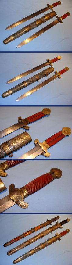 Chinese double straight sword (Shuang Jian), 22 & 1/2 inches overall in the scabbard and just over 20 inches out of the scabbard. The blades show clear forging lines in places and are as clean and untouched as the day the were made some 120-150 years ago. The scabbard is bound in dyed blue ray skin,all fittings exibit the Chinese bat for good luck and the Buddhist symbols of longevity. fluted red lacquered hilt grips. The other Jian are shown for comparission only.