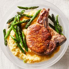 Cajun Skillet Pork Chops with Asparagus & Cheesy Polenta - The Cajun pork chop rub adds a delicious smoky flavor to this easy skillet dish. This polenta has a nice sharp bite thanks to Cheddar cheese. Don't have any on hand? Try Parmesan or Gouda instead. Polenta Recipes, Pork Recipes, Cooking Recipes, Healthy Recipes, Healthy Food, Cooking Tips, Recipies, Healthy Eating, Gouda