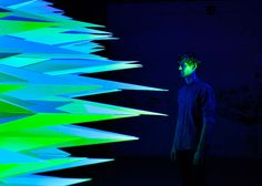 Red, blue and green spotlights were used to cast light onto the panel's protruding polygons, creating a 10-minute-long sequence of moving an...