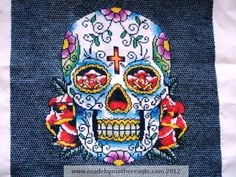 Candy Skull cross stitch. That isn't dark fabric, that's all blackwork for the background. Amazing!