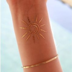 "This is a gold temporary tattoo of a lovely sun design. This tattoo is perfect for wearing to the beach! Sheet Size: 2"" x 2"" - Lasts 5-7 days even with swimming and bathing! - Easy to put on and easy"