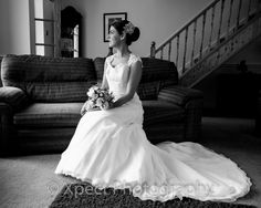Black and White photo of bride before setting off for her wedding ceremony. Bridal preps.
