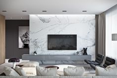 Marble isn't just for floors anymore. This slab-style wall brings this livin… Marble isn't just for floors anymore. This slab-style wall brings this living room from simple to spectacular. Living Room Interior, Home Living Room, Home Interior Design, Living Room Decor, Design Interiors, Feature Wall Living Room, Tv Feature Wall, Living Room Tv Unit Designs, Floors