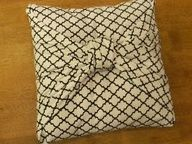 No Sew Cushion covers. use knotted side as back? Possibly secure with some safety pins?? no permanent cutting of any fabric - I can totally take it off the cushions whenever! Favorite and most do-able idea so far! (Since Im not quite a sewer...haha)