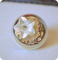 Vintage Upcycle Flower collage ring. $9.00, via Etsy.