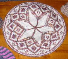 Faux Fair Isle. Fun tam.  I did six similar tams for the holidays, but this is a cute pattern too.  Free from Knitty