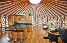 Open concept yurt living space - Pacific Yurts