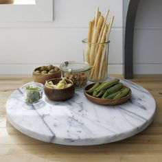 put your salt and pepper into marble shakers and keep them on a lazy suzan or tray to create the ultimate marble kitchen table centerpiece