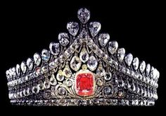 The Russian Nuptial Tiara. Worn by the imperial brides is most notable for its central pink diamond, a rose-colored stone of impeccable quality which comes from the treasury of Emperor Paul I (1754-1801) and is more than 10 carats.