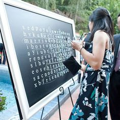 wedding games How easy is this DIY wedding idea! You can easily make a big chalkboard word search using a frame and chalkboard paint. Its one of our favourite outdoor wedding games and entertainment ideas.For more wedding games, visit Hitched Wedding Table Games, Wedding Games For Kids, Rustic Wedding Games, Outdoor Wedding Games, Shoe Game Wedding, Reception Games, Wedding Reception Planning, Wedding With Kids, Wedding Activities