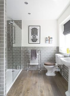This image of a refurbishment in Buckinghamshire posted by Interior Therapy has been saved more than 91000 times by Houzz users.The classic but modern space features grey tiles and a personal typography poster on the wall