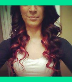 Red peek-a-boo hair under brown.