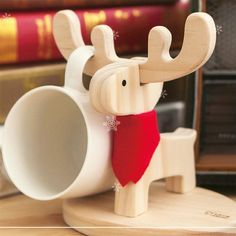 Deer cup holder is made by pine tree and can hold max. 2 cups. The deer is not only a cup holder; it can also be an accessory holder to display your j...
