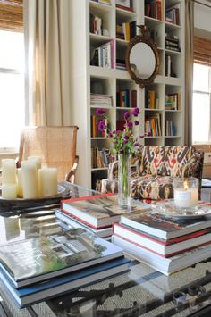 Bookcase styling in back - cubes instead of shelves, mirror hung in center // LeSueur Interiors.