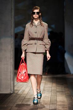 Prada Fall 2013 - As artsy & heady as Miuccia is, she is also the consummate salesgirl. She knows how to get women to buy things by presenting them beautifully. So for all the girls-gone-bad, there were moments of refined, pulled-together prettiness.