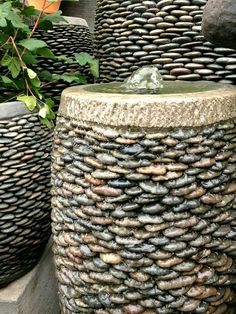 Bubbling Fountains in Pebble Pots: 21 Lovely DIY Ideas To Spice Up Garden with Pebbles Art Spiral Garden, Pebble Garden, Garden Spheres, Garden Fountains, Water Fountains, Pebble Mosaic, Pebble Art, Pebble Stone, Stone Art