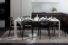 Kartell Complete Dining Package    1 x Four Table (190 cm), black or white  6 x Masters Chairs, white, black or grey        RRP $3,635  Now $2,595