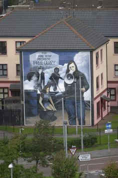 Things to do in Derry - Political wall murals on building #ireland #derry #europe #city #discover #guinness #pub #experience #history #travel #traveltherenext #wallofderry
