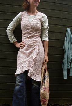 This is not an apron this is a WRAP AROUND DRESS and over the jeans, o so cool