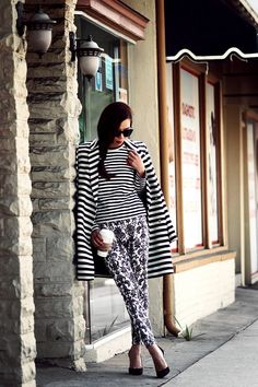 striped coat and top with graphic pants