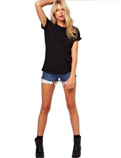 This super soft black tee is lightweight enough to wear over your favorite swimsuit with a pair of jean shorts, or with a pair of skinny jeans, black wedges, and stack on some of our jewelry and you've got the perfect outfit for a night on the town.     Free Shipping!  Available in Small and Medium  Semi-Sheer
