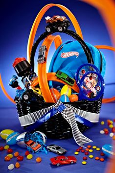 """Hot Wheels Easter Basket - did for Sam.  Lots of cars didn't fit in eggs, but the tracks looked awesome.  Added some """"launchers.""""  Lots of fun!"""