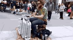 """Video has emerged of """"pipe guy"""" in Adelaide, dominating the weak foundations of music with this self-made PVC pipe instrument.----this guy is epic!!!"""