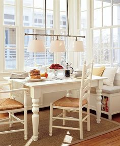 If only I have windows like this... But I love the table, chairs, and bench idea!