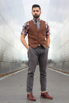 Shop this look for $190:  http://lookastic.com/men/looks/tie-and-dress-shirt-and-waistcoat-and-watch-and-chinos-and-brogues/3324  — Grey Tie  — Charcoal Plaid Dress Shirt  — Brown Wool Waistcoat  — Dark Brown Leather Watch  — Charcoal Chinos  — Burgundy Leather Brogues