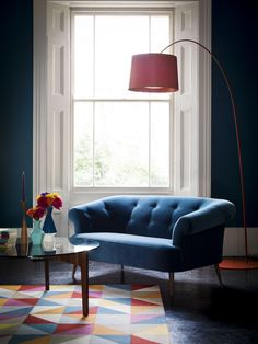 This mid-century style sofa takes inspiration from the simple and curvaceous frames synonymous with 1950's furniture, No cushions to plump; with simple splayed arms and a buttoned back. This two-seat sofa is in Deep Turquoise Cotton Matt Velvet. The legs are beechwood with an 'oak' varnish finish, but also come in 'dark mahogany' and 'French white'.