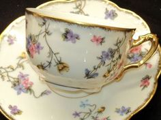 Lanternier Limoges...teacup and saucer with a tiny floral pattern and gold gilt trim