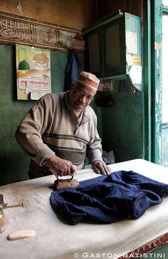 Ironing man, Cairo, Egypt by Batistini Gaston, via Flickr