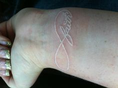 Don't like this..... Was thinking a white infinity tattoo before seeing this.