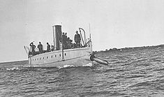 Torpedo Boat Stilletto launching a Howell torpedo about 1890