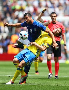 Graziano Pelle of Italy is tackled by Albin Ekdal of Sweden during the UEFA EURO 2016 Group E match between Italy and Sweden at Stadium Municipal on...