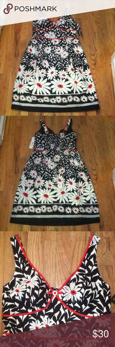 """Madison Leigh Dress NWT Madison Leigh floral dress. Size 12. Black, white, & red. Bust is lightly lined/padded. Zips in back. Straps are adjustable to two lengths, using a button. Pleated front. The top back is stretchy. 97% cotton & 3% spandex. Lining: 100% polyester. Made in Sri Lanka.  Approximate measurements, laying flat: 43"""" - 43 1/2"""" total length, 17 3/4"""" arm pit to arm pit, & 17"""" waist.  NO TRADES, HOLDS, OR MODELING. Madison Leigh Dresses Midi"""