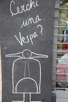 vintage Vespa shop, via Flickr.