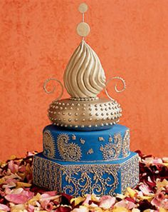 Moroccan inspired wedding cake.  Incorporates mosque architectural elements, henna tattoo patterns, and intricate embroidery.