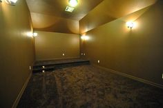 Man Cave or also called the Media Room has High Ceilings, Stepping Lights and more waiting for you!