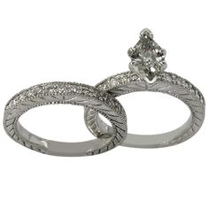Two Ring Antique Diamond Engagement Mounting Any Center -  This antique ring set is adorned with a combined total of 0.70ct of round accent diamonds and will accommodate any shape and size center diamond.    It is comprised of an engagement ring and a matching wedding band crafted in solid 14K white gold. They feature a delicate engraved pattern on the sides. Both pieces are set with brilliant diamond accents on the half top. This style of wedding ring is popular and in demand. Worthy of…