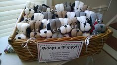 """'Washcloth Puppy Dog' (really it's a cheap bath hand towel from Target) favor display for """"Snips and Snails and Puppy Dog Tails"""" boy baby shower.  Photo directions to make Puppies found at (http://stranamasterov.ru/node/757889)."""
