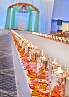 Suhaag Garden, Jodha Akbar theme mandap, mint green chiffon drapes, cylinder vase, floating candles, aisle