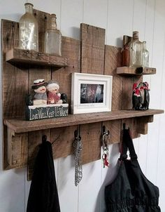 The hooks are pinned in the pallets and then the rack is attached to the wall, the hanging option allows hanging anything just like the bag and the coat shown here. The decorative items look best when placed on the shelves, the bottles are decorated on the upper level; which can be replaced by anything.