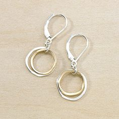 """A little duo of slightly irregular circles are stacked together for alightweight pair of earrings. The inner circle is gold filled;the outer circle is sterlingsilver. Perfect for wearing with your gold or silver jewelry! - all components are sterling silver or gold filled-outsidediameter measures just over a 1/2"""""""