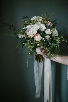 Seasonal flowers for a winter wedding bouquet. Photography by Joanna Brown.